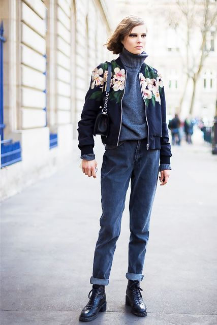 With turtleneck sweater, cuffed jeans, mini bag and floral bomber jacket