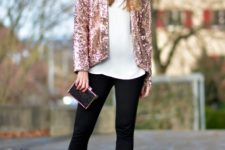With white blouse, black skinny pants, mini clutch and black shoes
