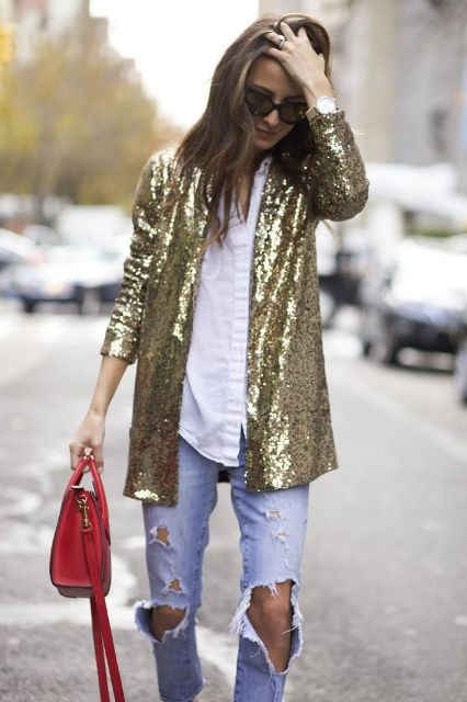 With white button down shirt, distressed jeans, sunglasses and red bag