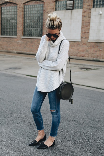 With white loose sweater, distressed skinny jeans and black flats