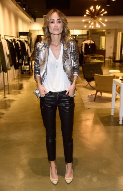 With white loose t-shirt, leather pants and beige pumps