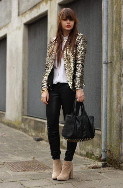 With white shirt, black pants, black bag and beige suede ankle boots
