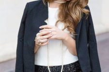 With white shirt, navy blue blazer and necklace