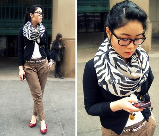 With white shirt, navy blue bomber jacket, light brown pants and red flat shoes