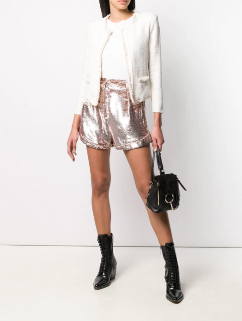 With white shirt, white blazer, small bag and black patent leather lace up boots