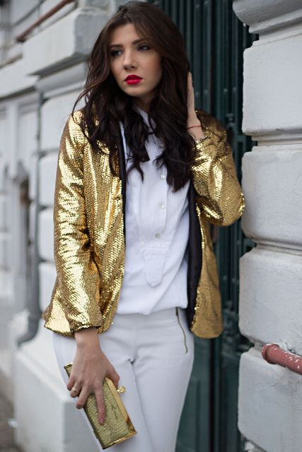 With white shirt, white pants and golden clutch