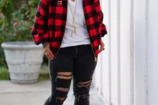With white t-shirt, distressed jeans and red sneakers