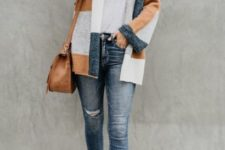 With white t-shirt, distressed skinny jeans, brown bag and ankle boots