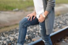 With white t-shirt, gray cardigan and distressed jeans
