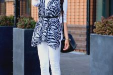 With white turtleneck, black cap, white skinny pants, pale pink shoes and black bag
