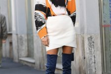 With white wrapped skirt, printed blouse and bag