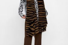 With zebra printed shirt, brown pants and printed leather boots