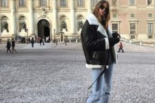 a black shearling coat with white fur, blue cropped jeans, white heeled booties for an ultimate winter look