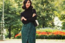 a black turtleneck, a forest green wrap midi skirt on buttons, vintage-inspired two tone shoes and a bag