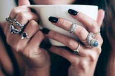 a boho setup of silver rings with various complementing shapes and large rhinestones