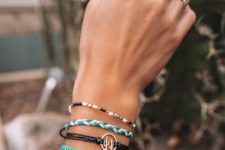 a bracelet stack with colorful touches – turquoise and white plus a chic cactus pendant for a boho feel