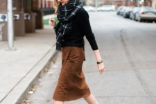 a casual outfit with a black top, a brown suede wrap skirt, black booties and a printed scarf