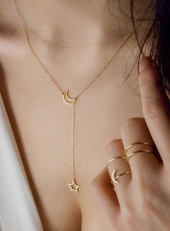 a celestial gold lariat necklace with a half moon and a star for a delicate touch to your outfit