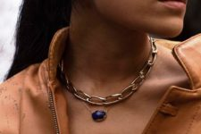 a chunky chain collar plus a delicate necklace with a statement purple pendant for a cool modern look