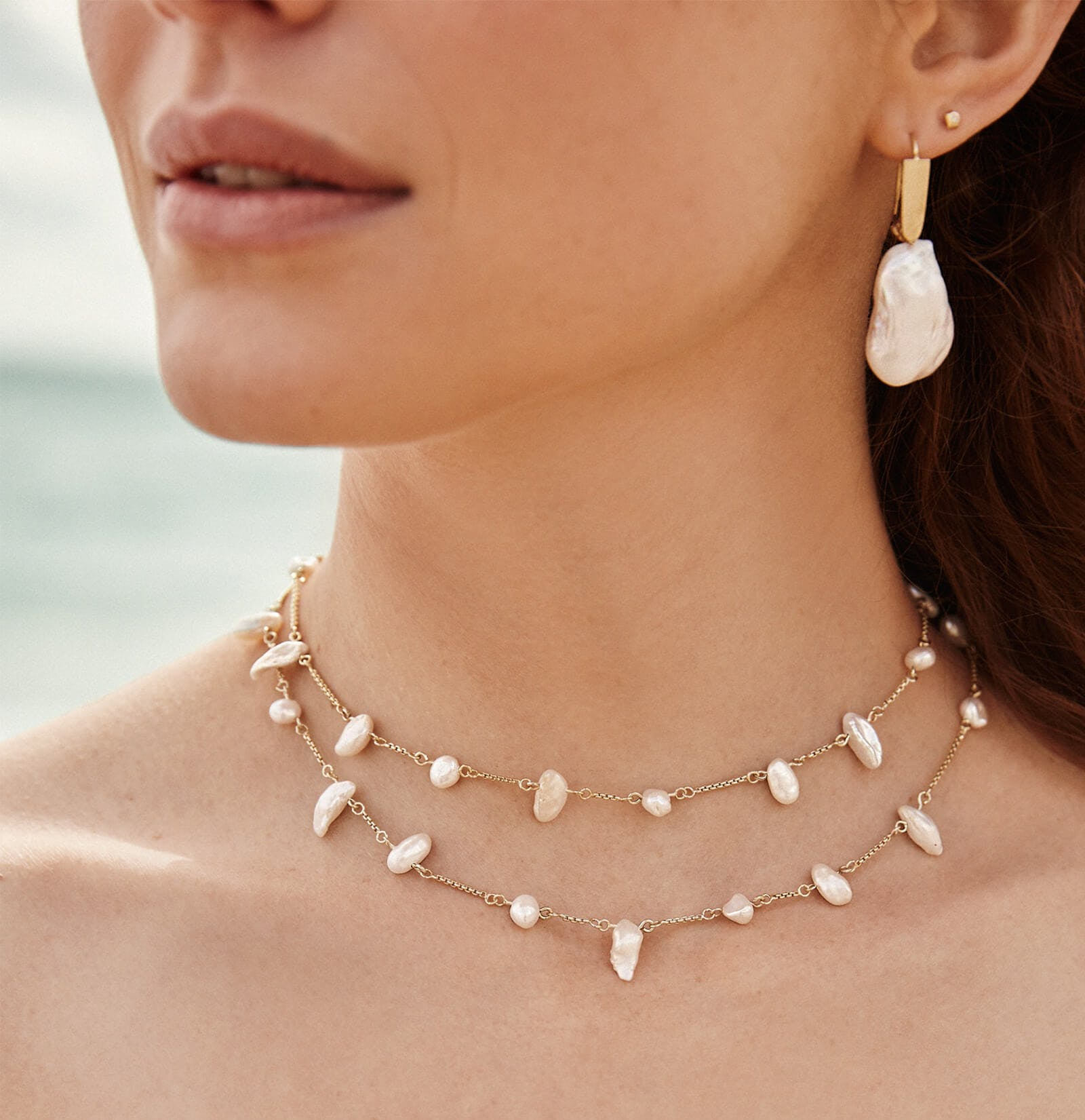 a combo of a two tier baroque pearl necklace plus a matching mono earring for a bold modern look