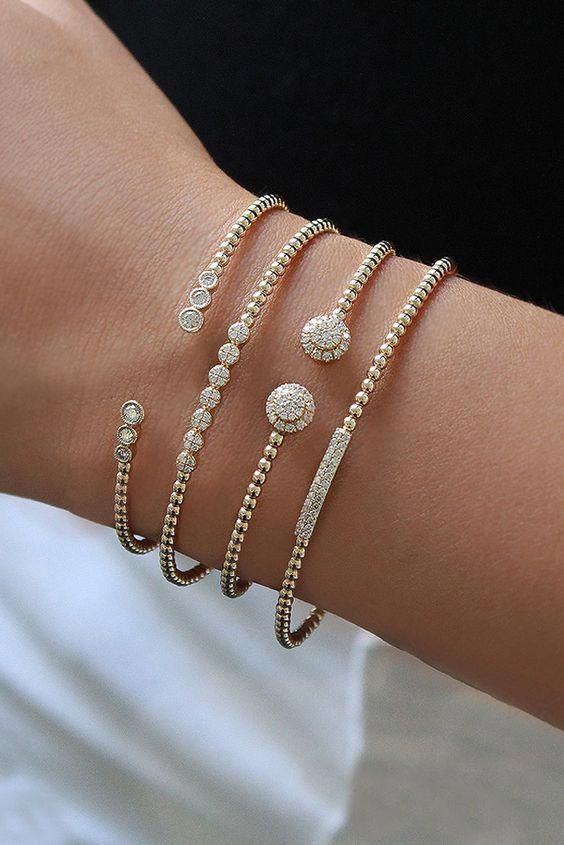 a combo of elegant and girlish bracelets of gold and diamonds that are similar but a bit different