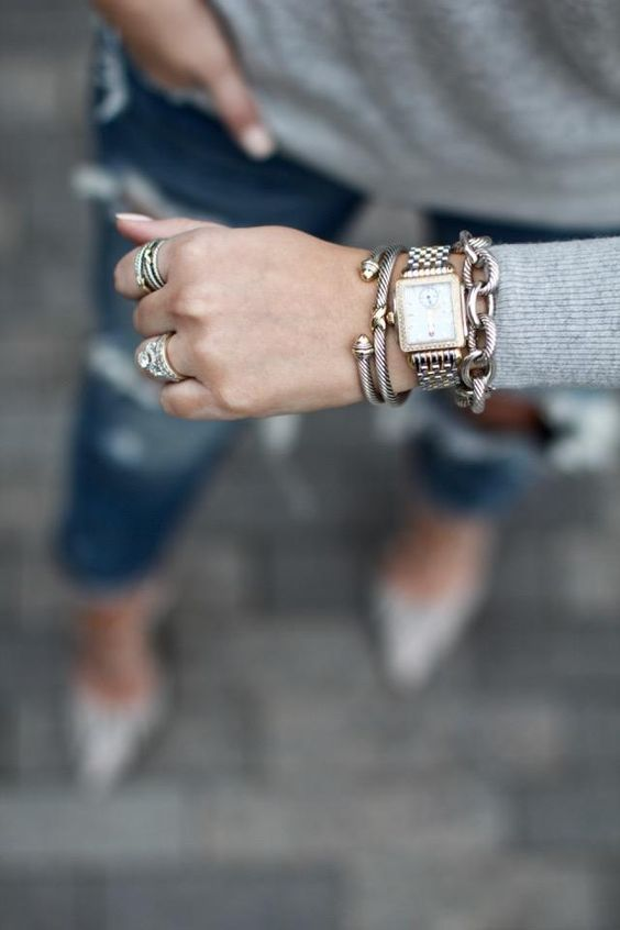 a combo of three different bracelets but in the same style and a matching watch for more chic
