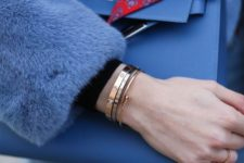 a combo of three similar yet different bracelets of various metals is a very chic idea to rock right now