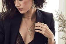 a double choket necklace paired with a long lariat one with a statement rhinestone for a luxurious look