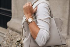 a gold and silver finish bracelets and a gold finish watch in between – mixing metals is trendy