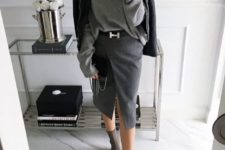 a grey oversized sweater, a graphite grey wrap pencil skirt, sock boots and a black leather jacket