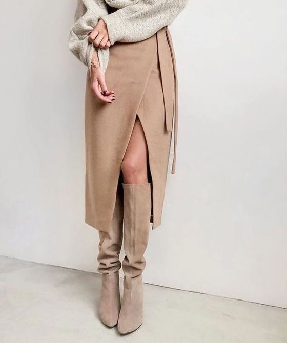 a grey oversized top, a tan wrap midi skirt and matching suede boots for a luxurious minimal look