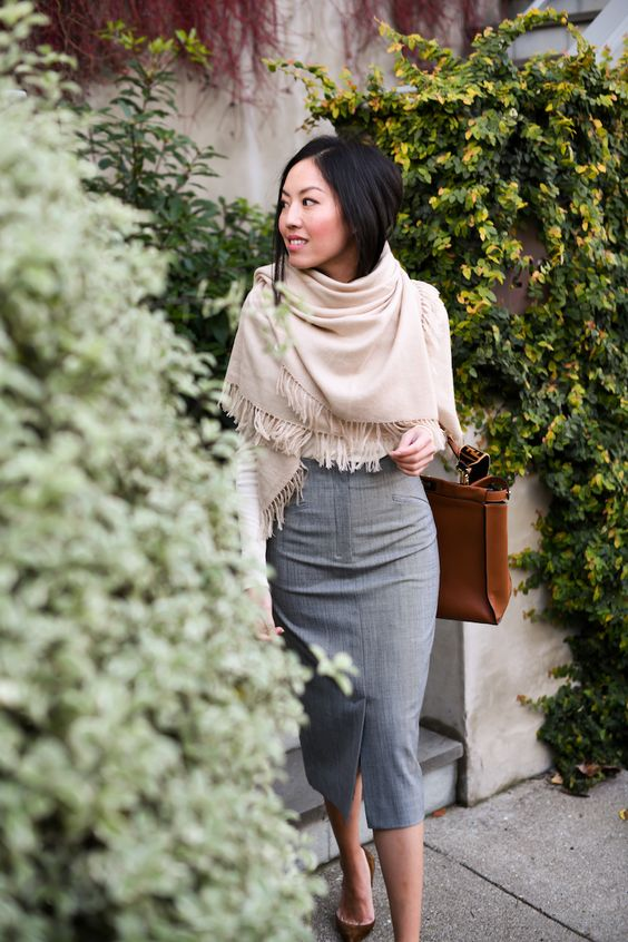 a grey pencil midi with a front slit, brown shoes, a tan scarf covering the upper part for a cold day