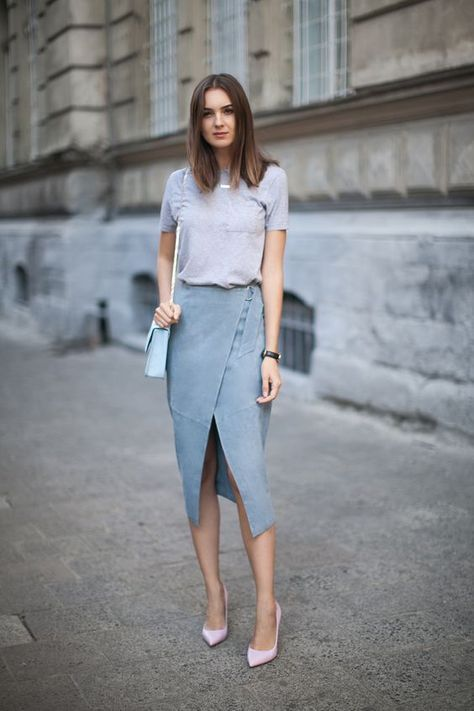 a grey tee, a blue denim midi skirt with an asymmetric front slit, pink shoes and a blue bag