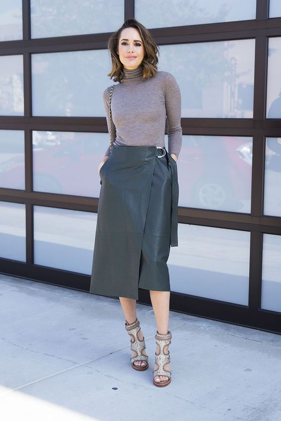 a lavender turtleneck, a graphite grey leather wrap midi skirt and whimsy cutout shoes