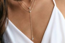 a layered gold chain lariat necklace with rhinestones will accent any look and make it wow