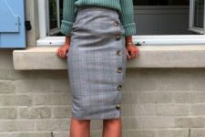 a light green turtleneck, a grey tweed wrap skirt with buttons, apple green suede shoes