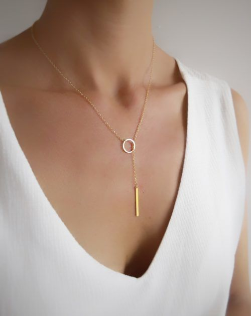a minimalist gold lariat necklace with a circle and a vertical bar is a chic and bold idea to rock