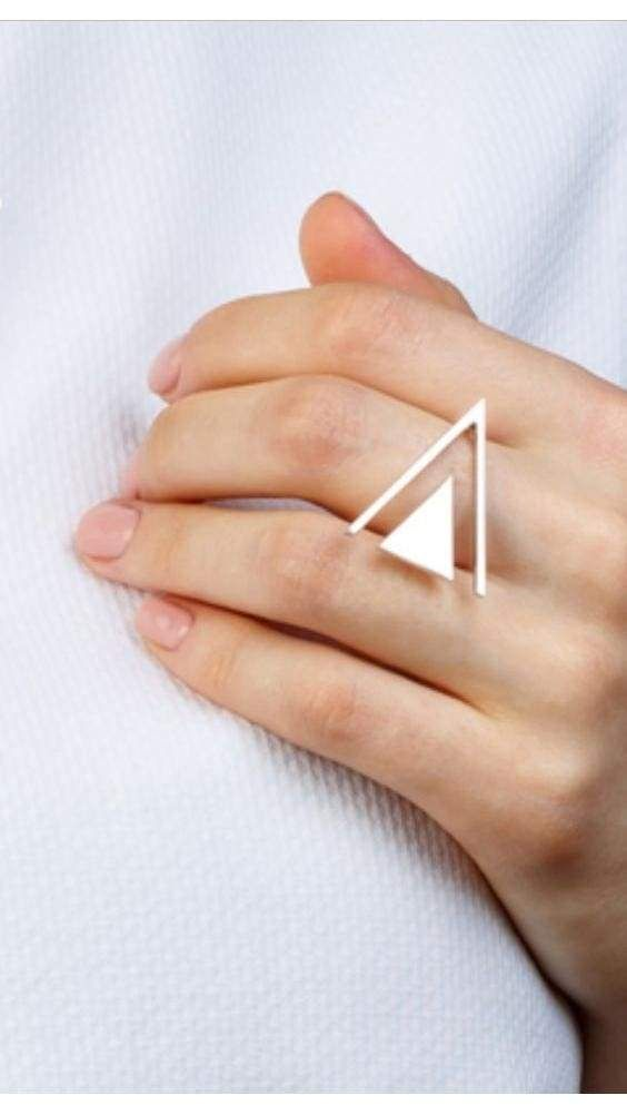 a modern geometric silver ring is a bold and cool statement for a modern outfit