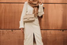 a neutral winter look with an oversized chunky sweater, a white leather pencil skirt, matching boots, a tan bag and a rust-colored scarf