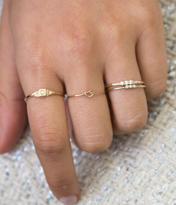 a number of rings including two stacked ones that are very complementing looks cool and bold