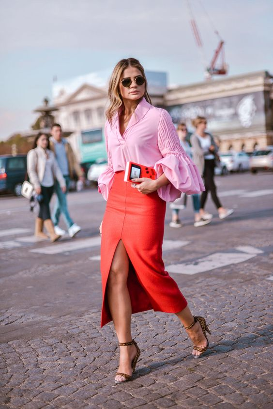 a pink blouse with puff sleeves, a red high waisted pencil midi with a front slit and leopard print shoes for a special occasion