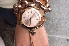 a stack fo rose gold bracelets – heavy chains and a leather studded one plus a watch on a studded leather strap