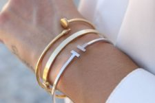 a stack of ultra-modern bracelets with mixed metals is a chic and stylish idea to go for