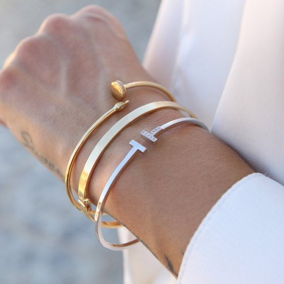 a stack of ultra modern bracelets with mixed metals is a chic and stylish idea to go for