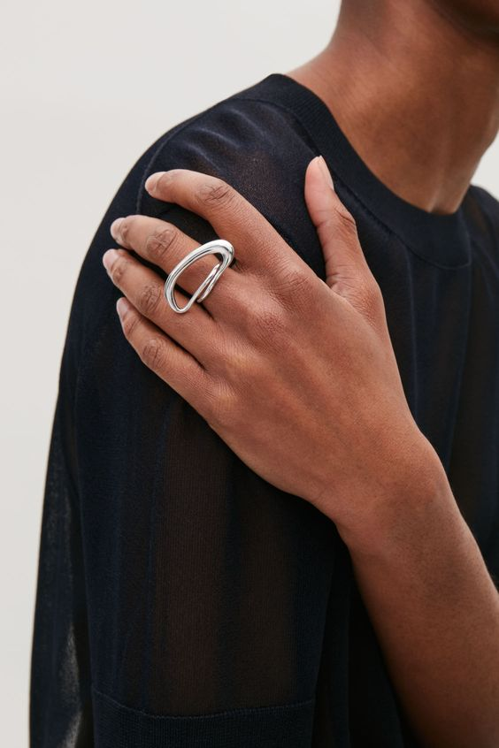 a statement silver abstract ring is great to accent any minimalist look and will catch an eye