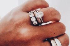 a statement stackable ring set with large rhinestone ones and simple sleek thick ones