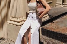 a summer look with a retro-inspired neutral top, a white button midi with a slit, leopard print slippers and a brown bag