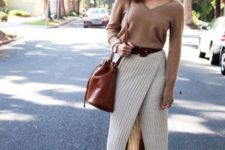 a tan cashmere top, a cream striped wrap pencil midi skirt, rust-colored boots and a matching bag