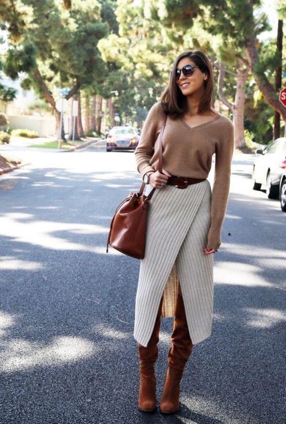 a tan cashmere top, a cream striped wrap pencil midi skirt, rust colored boots and a matching bag