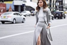 a total dove grey look with a white turtleneck, a midi A-line wrap skirt, booties and a short coat with faux fur